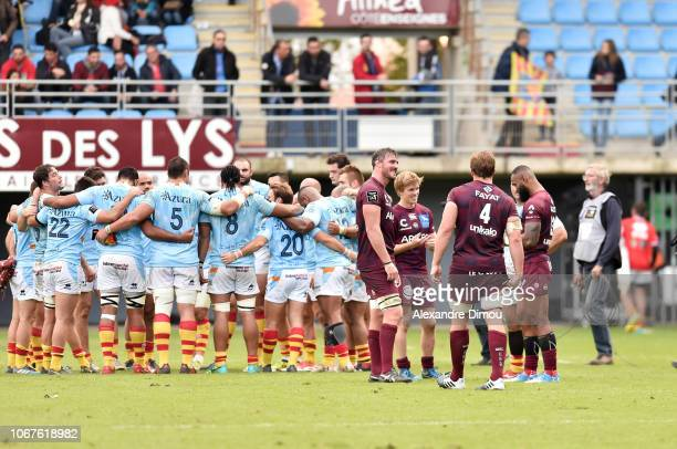 Jadre Marais and Kane Douglas adn Blair Connor and Semi Radradra of BordeauxBegles celebrates the victory and Team of Perpignan looks dejected after...