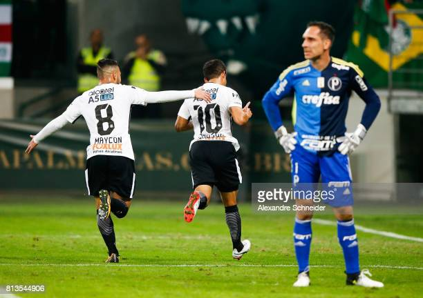 Jadson #10 of Corinthians celebrates after scoring their first goal during the match between Palmeiras and Corinthians for the Brasileirao Series A...