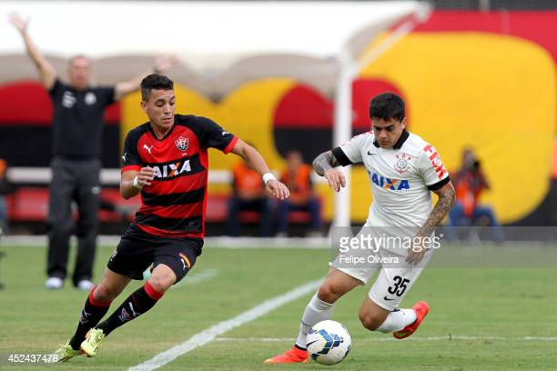 Jadson of Corinthians battles for the ball during the match between Vitoria and Corinthians as part of Brasileirao Series A 2014 at Estadio Manoel...