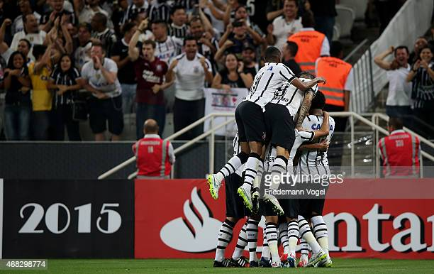 Jadson of Corinthians celebrates scoring the first goal with his team during a match between Corinthians and Danubio as part of Group 2 of Copa...