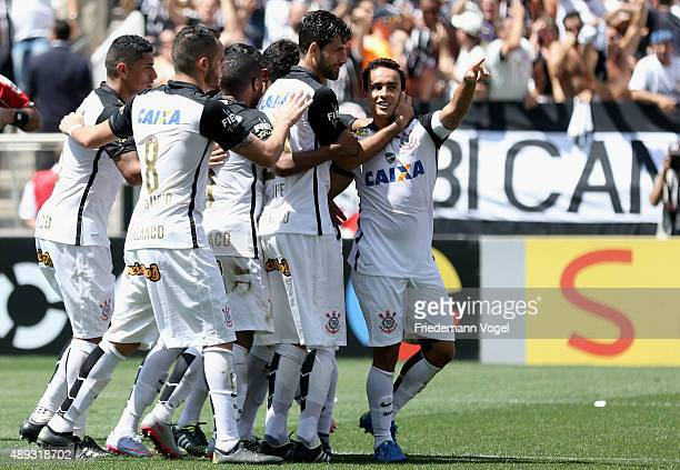 Jadson of Corinthians celebrates scoring the first goal with his team during the match between Corinthians and Santos for the Brazilian Series A 2015...