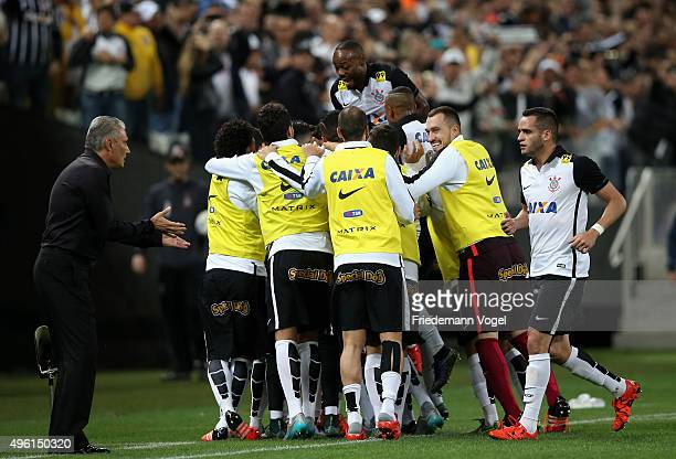 Jadson of Corinthians celebrates scoring the first goal with his team during the match between Corinthians and Coritiba for the Brazilian Series A...