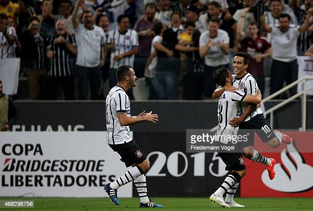Jadson of Corinthians celebrates scoring the first goal with Uendel and Renato Augusto during a match between Corinthians and Danubio as part of...