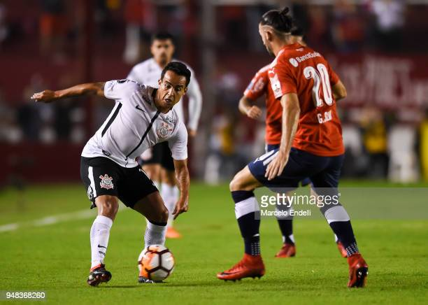 Jadson of Corinthians fights for ball with Gaston Silva of Independiente during a Group 7 match between Independiente and Corinthians as part of Copa...