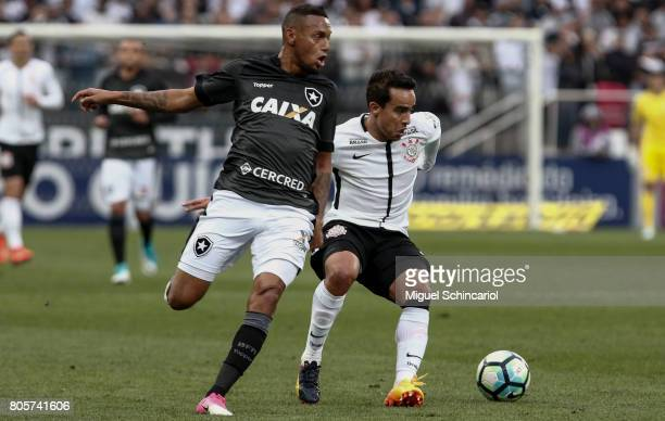 Jadson of Corinthians vies for the ball with Gilson of Botafogo during the match between Corinthians and Botafogo for the Brasileirao Series A 2017...