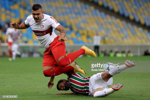 Jadson of Fluminense struggles for the ball with William Pottker of Internacional during a match between Fluminense and Internacional as part of...