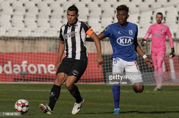 Jadson of Portimonense SC with Mateo Cassierra of Belenenses SAD in action during the Liga NOS match between Belenenses SAD and Portimonense SC at...