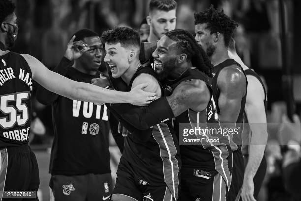 Jae Crowder and Tyler Herro of the Miami Heat smile and celebrate on the court after Game Four of the Eastern Conference Finals against the Boston...
