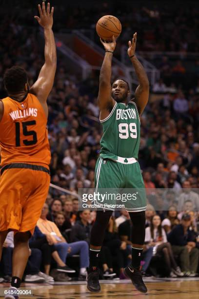 Jae Crowder of the Boston Celtics attempts a shot over Alan Williams of the Phoenix Suns during the second half of the NBA game at Talking Stick...