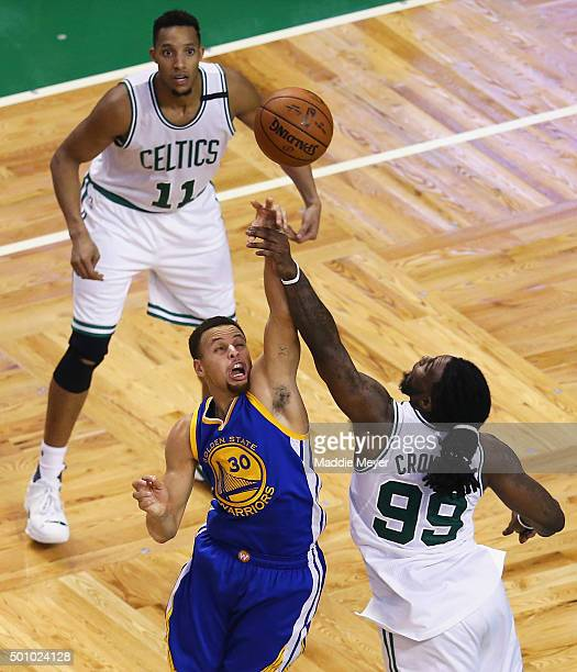Jae Crowder of the Boston Celtics blocks a shot by Stephen Curry of the Golden State Warriors during double overtime at TD Garden on December 11,...