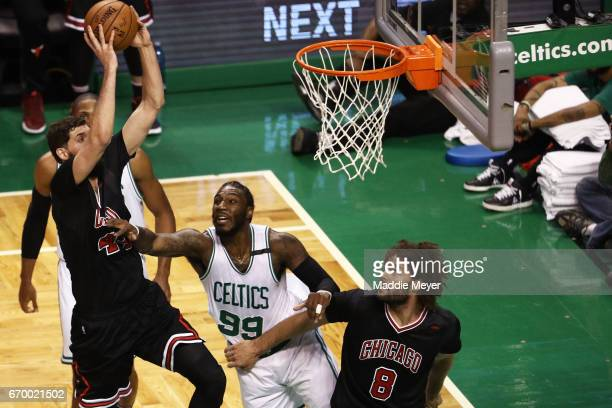 Jae Crowder of the Boston Celtics defends a shot from Nikola Mirotic of the Chicago Bulls during the first quarter of Game Two of the Eastern...