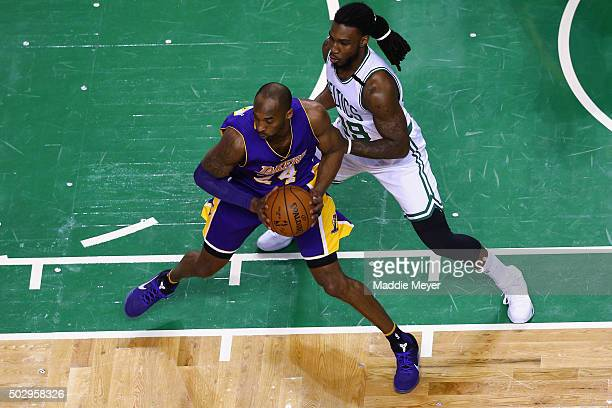 Jae Crowder of the Boston Celtics defends Kobe Bryant of the Los Angeles Lakers during the first quarter at TD Garden on December 30 2015 in Boston...
