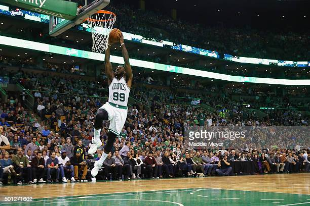 Jae Crowder of the Boston Celtics dunks against the Golden State Warriors during the third quarter at TD Garden on December 11 2015 in Boston...