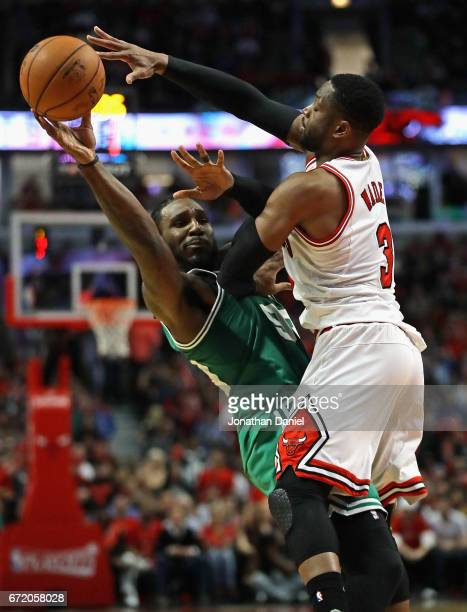 Jae Crowder of the Boston Celtics passes under pressure from Dwyane Wade of the Chicago Bulls during Game Four of the Eastern Conference...