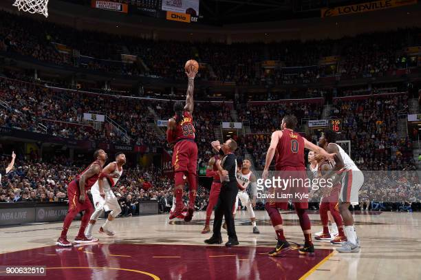 Jae Crowder of the Cleveland Cavaliers goes for the tip off against the Portland Trail Blazers on January 2 2018 at Quicken Loans Arena in Cleveland...