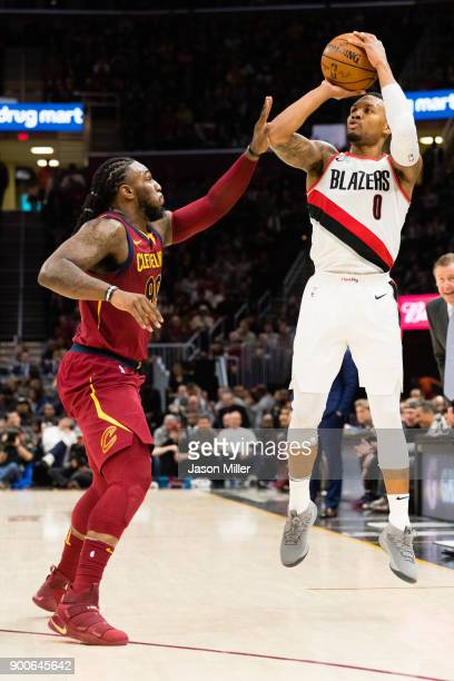 Jae Crowder of the Cleveland Cavaliers guards Damian Lillard of the Portland Trail Blazers during the second half at Quicken Loans Arena on January 2...