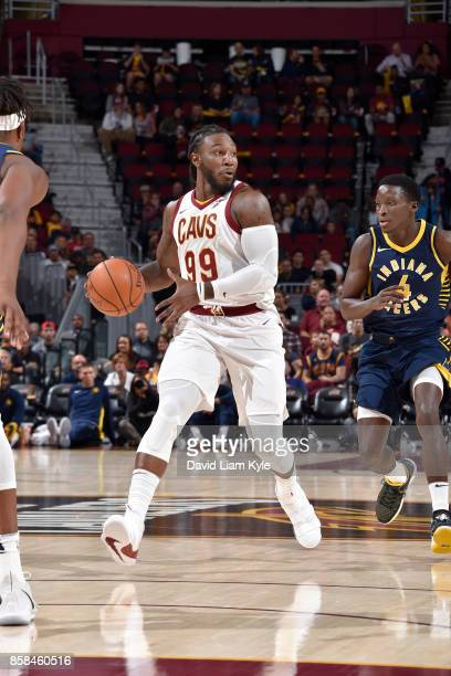 Jae Crowder of the Cleveland Cavaliers handles the ball during the preseason game against Victor Oladipo of the Indiana Pacers on October 6 2017 at...