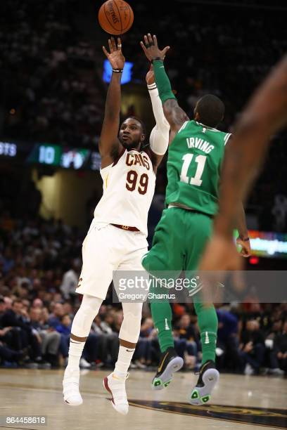 Jae Crowder of the Cleveland Cavaliers takes a shot behind Kyrie Irving of the Boston Celtics at Quicken Loans Arena on October 17 2017 in Cleveland...