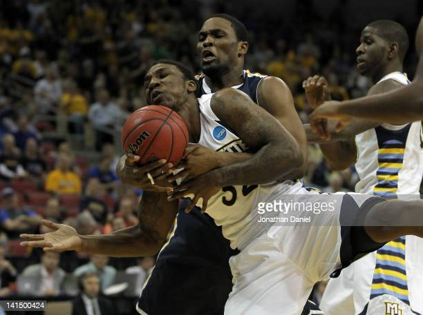 Jae Crowder of the Marquette Golden Eagles and Ivan Aska of the Murray State Racers battle for a rebound in the first half during the third round of...
