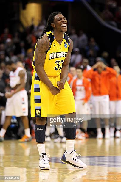 Jae Crowder of the Marquette Golden Eagles celebrates late in the game against the Syracuse Orange during the third of the 2011 NCAA men's basketball...