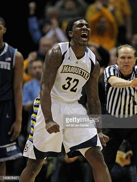 Jae Crowder of the Marquette Golden Eagles celebrtaes hitting a shot and being fouled against the Georgetown Hoyas at the Bradley Center on March 3...
