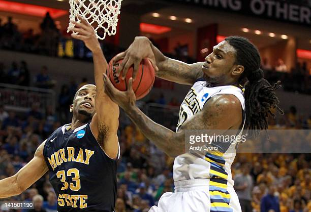 Jae Crowder of the Marquette Golden Eagles grabs a rebound against Jewuan Long of the Murray State Racers in the second half during the third round...