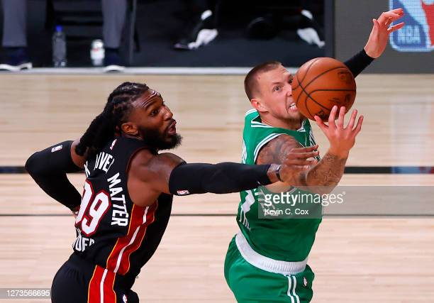 Jae Crowder of the Miami Heat and Daniel Theis of the Boston Celtics battle for a rebound during the third quarter in Game Three of the Eastern...