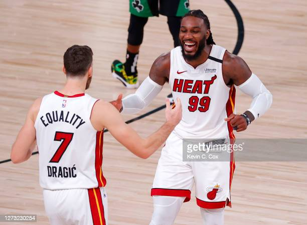 Jae Crowder of the Miami Heat and Goran Dragic of the Miami Heat react after their win over Boston Celtics in Game Two of the Eastern Conference...