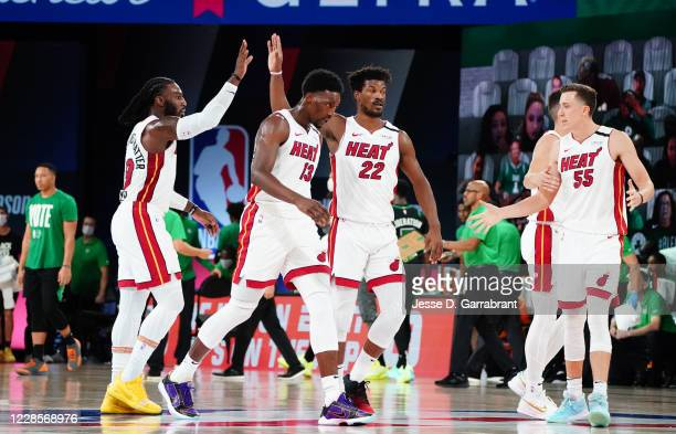 Jae Crowder of the Miami Heat and Jimmy Butler of the Miami Heat high-five during a game against the Boston Celtics during Game Two of the Eastern...