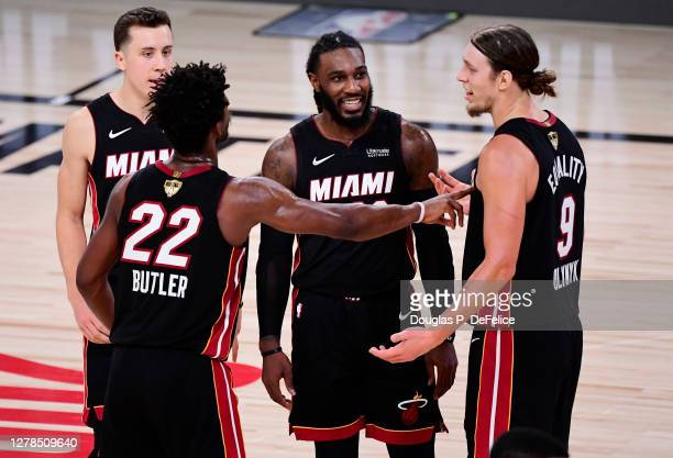Jae Crowder of the Miami Heat reacts with Duncan Robinson, Jimmy Butler and Kelly Olynyk during the fourth quarter against the Los Angeles Lakers in...