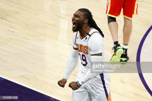 Jae Crowder of the Phoenix Suns celebrates after hitting a three-point shot against the Atlanta Hawks during the second half of the NBA game at...