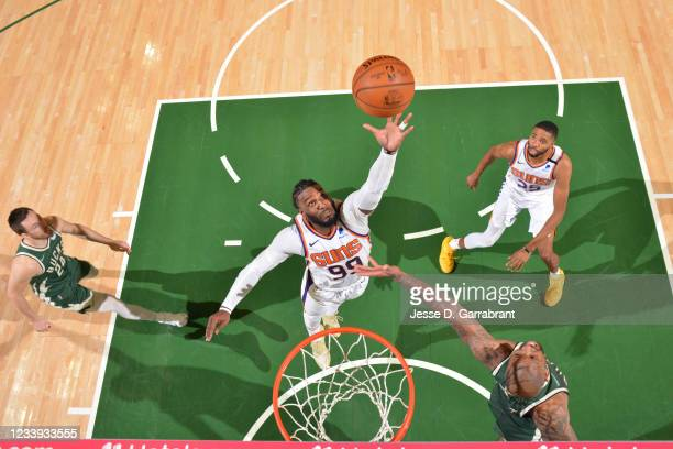 Jae Crowder of the Phoenix Suns grabs the rebound against the Milwaukee Bucks during Game Three of the 2021 NBA Finals on July 11, 2021 at Fiserv...