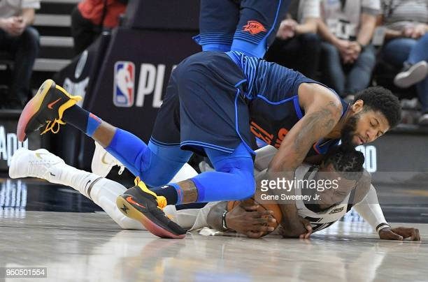 Jae Crowder of the Utah Jazz and Paul George of the Oklahoma City Thunder fight for the ball in the first half during Game Four of Round One of the...
