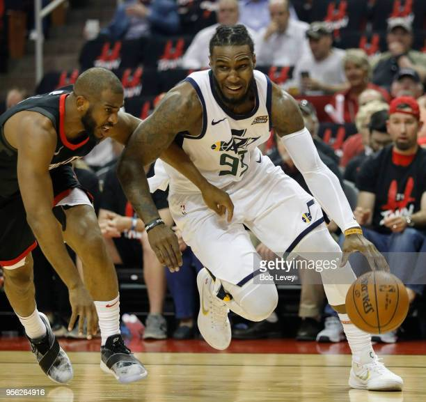 Jae Crowder of the Utah Jazz drives around Chris Paul of the Houston Rockets during Game Five of the Western Conference Semifinals of the 2018 NBA...