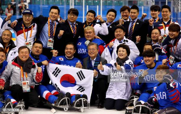 Jae In Moon president of Korea celebrate with bronmze medal winning team of Korea after the Ice Hockey bronze medal game between Korea and Italy...