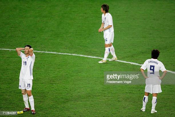 Jae Jin Cho Jin Kyu Kim and Jung Hwan Ahn are dejected after their 20 loss to Switzerland after the FIFA World Cup Germany 2006 match between...