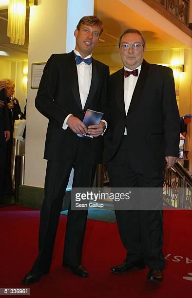 Jaecki Schwarz and Hagen Henning arrive at the Goldene Henne Awards at Friedrichstadtpalast on September 22, 2004 in Berlin, Germany.