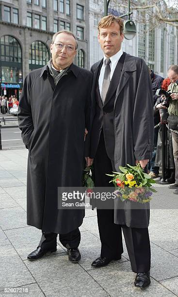 Jaecki Schwarz and his partner Hagen Henning arrive for funeral services for the late German actor Harald Juhnke at the Gedechniskirche church April...