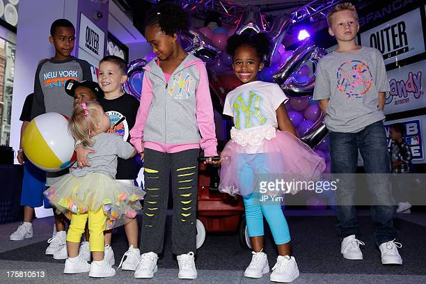 Jaeden Arie Sabathia Cyia Sabathia and guests attend the CCandy Children's Clothing Line Launch at MLB Fan Cave on August 8 2013 in New York City