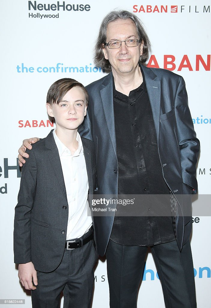 Jaeden Lieberher (L) and Bob Nelson arrive at the Los Angeles premiere of 'The Confirmation' held at NeueHouse Hollywood on March 15, 2016 in Los Angeles, California.