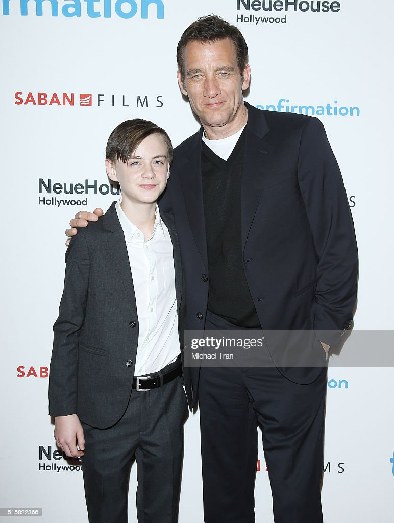 Jaeden Lieberher (L) and Clive Owen arrive at the Los Angeles premiere of 'The Confirmation' held at NeueHouse Hollywood on March 15, 2016 in Los Angeles, California.