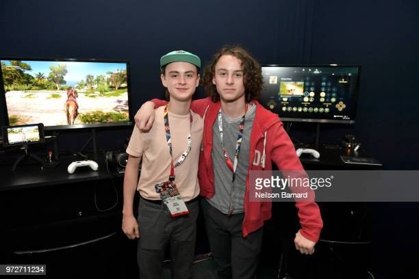Jaeden Lieberher and Wyatt Oleff playing Assassin's Creed Odyssey during E3 2018 at Los Angeles Convention Center on June 12 2018 in Los Angeles...