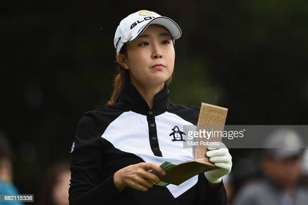 JaeEun Chung of South Korea looks at her yardage book on the 10th hole during the first round of the HokennoMadoguchi Ladies at the Fukuoka Country...