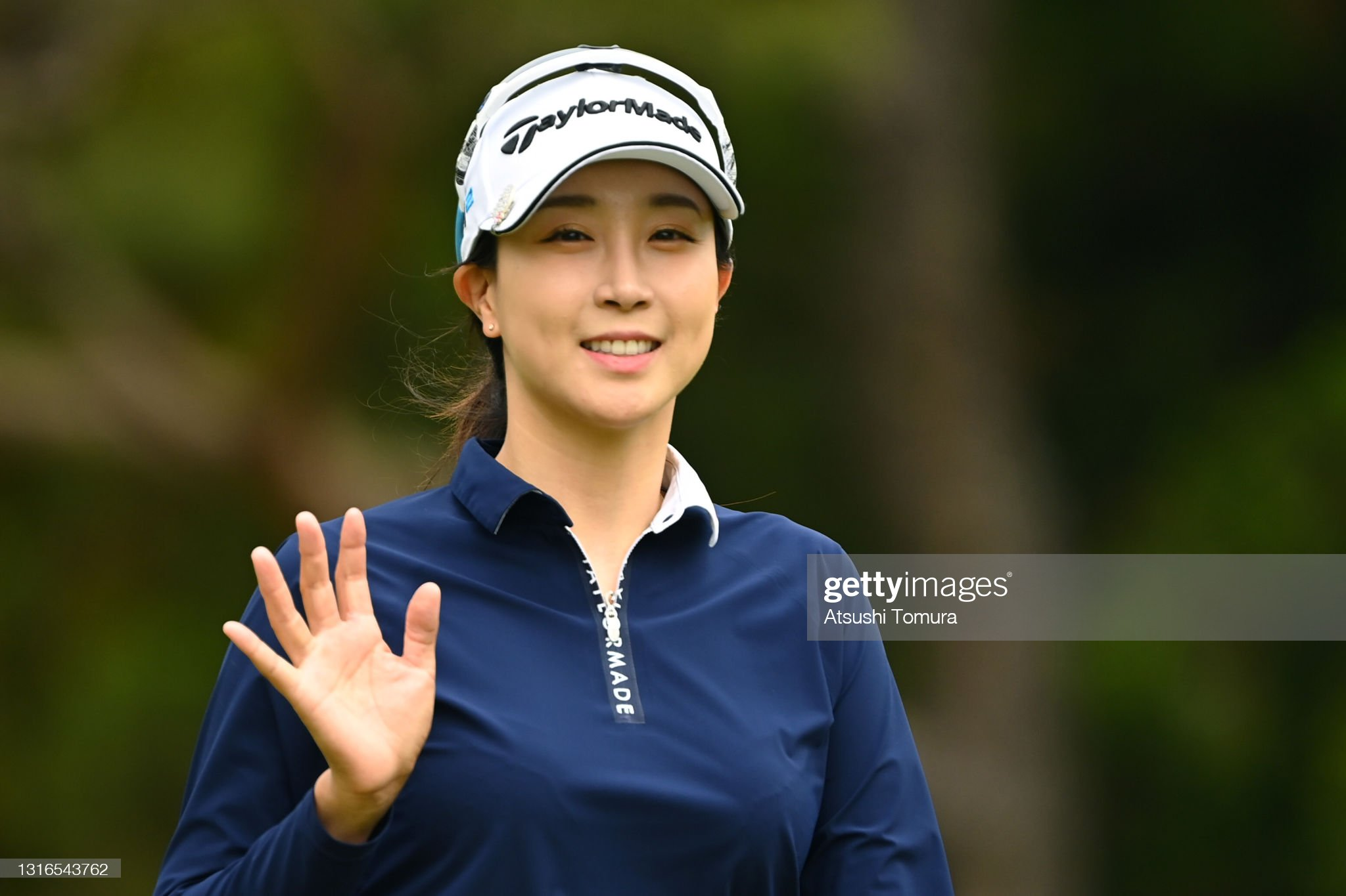 https://media.gettyimages.com/photos/jaeeun-chung-of-south-korea-waves-on-the-4th-hole-during-the-first-picture-id1316543762?s=2048x2048