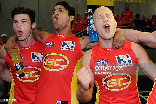 Jaeger O'Meara Aaron Hall and Gary Ablett celebrate after the round eight AFL match between the Gold Coast Suns and the Western Bulldogs at Metricon...