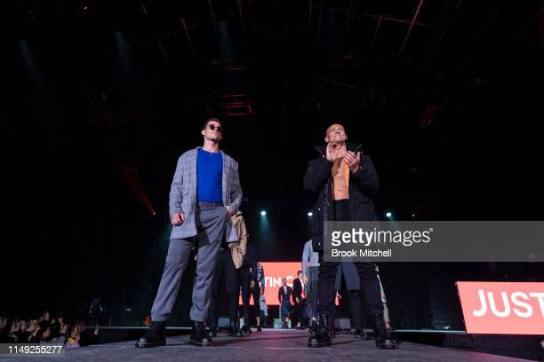 Jaeger O'Meara and Michael Klim walk the runway during the Justin Cassin show at MercedesBenz Fashion Week Resort 20 Collections at the Big Top Luna...