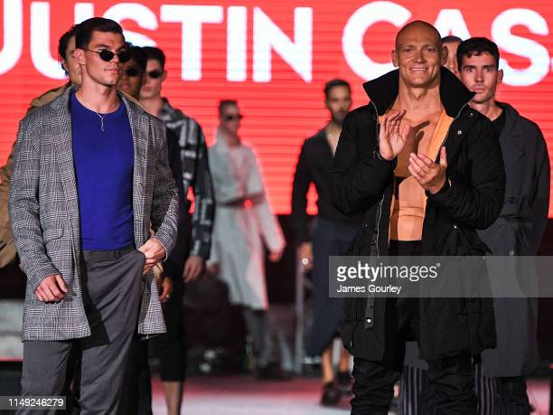 Jaeger O'Meara and Michael Klim walks the runway during the Justin Cassin show at MercedesBenz Fashion Week Resort 20 Collections at the Big Top Luna...