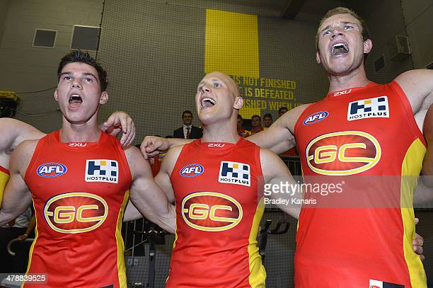 Jaeger O'Meara Gary Ablett and Sam Day celebrate victory after the round one AFL match between the Gold Coast Suns and the Richmond Tigers at...