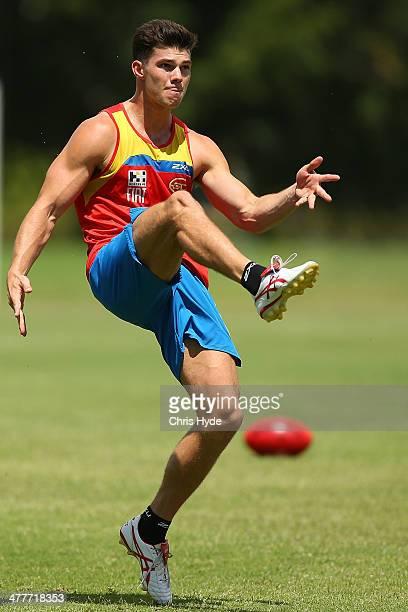 Jaeger O'Meara kicks during a Gold Coast Suns AFL training session at Metricon Stadium on March 11 2014 in Gold Coast Australia