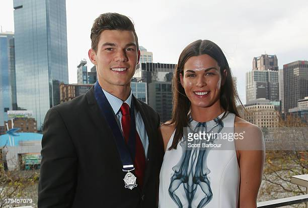 Jaeger O'Meara of the Gold Coast Suns poses with his girlfriend Rhiannon Joyce after winning the 2013 Ron Evans Medal NAB Rising Star Award as the...